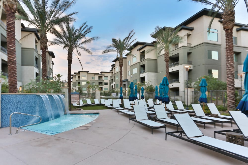 Beautiful fountain and chaise lounge chairs near the pool at Avant at Fashion Center in Chandler, Arizona