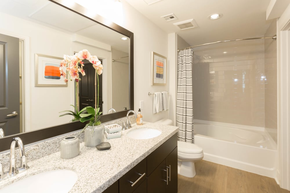 Large vanity mirror and granite countertops in bathroom of model home at Avant at Fashion Center in Chandler, Arizona