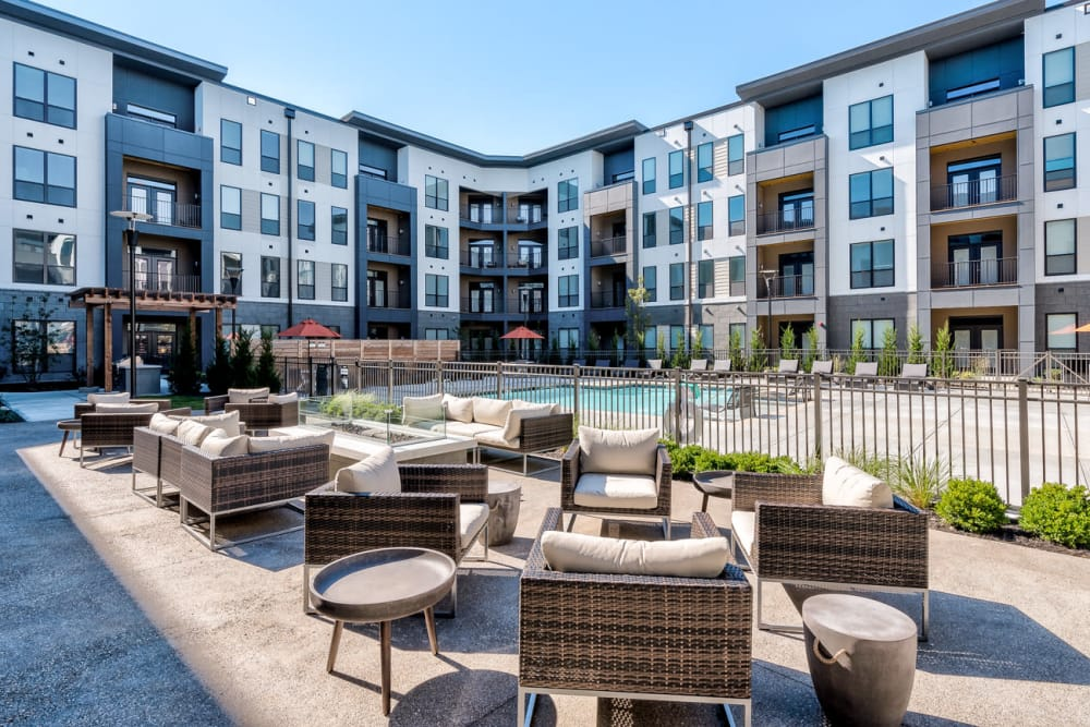 Outdoor seating near the pool at Echelon Luxury Apartments in Cincinnati, Ohio