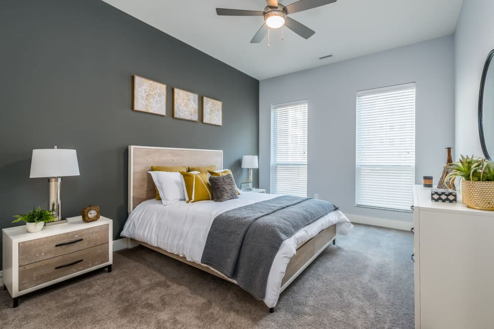 Bedroom with natural lighting and a ceiling fan at Echelon Luxury Apartments in Cincinnati, Ohio