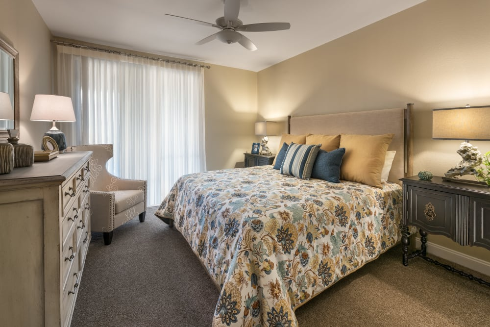 Large master bedroom with ceiling fan and beautiful furnishings in model home at San Piedra in Mesa, Arizona