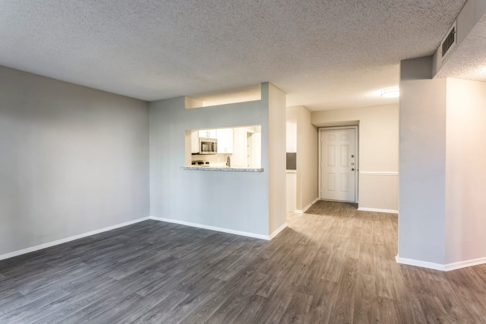 Hardwood floors in open-concept living area of apartment home at IMT Newport Colony in Casselberry, Florida