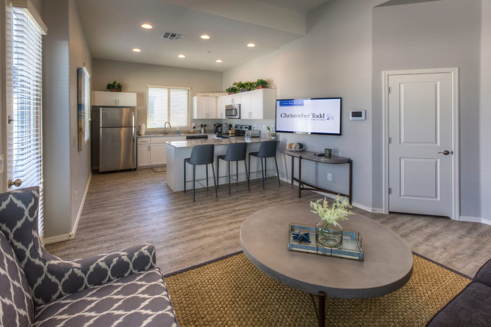Beautiful open-concept floor plan with hardwood floors in model home at Christopher Todd Communities At Marley Park in Surprise, Arizona