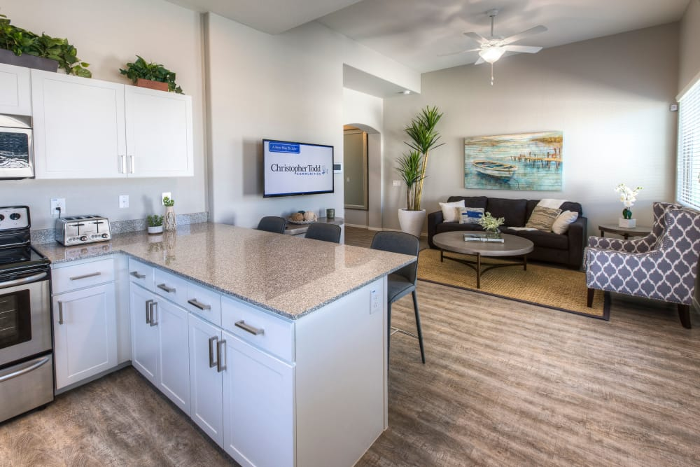 Modern kitchen with granite countertops in model home at Christopher Todd Communities At Marley Park in Surprise, Arizona