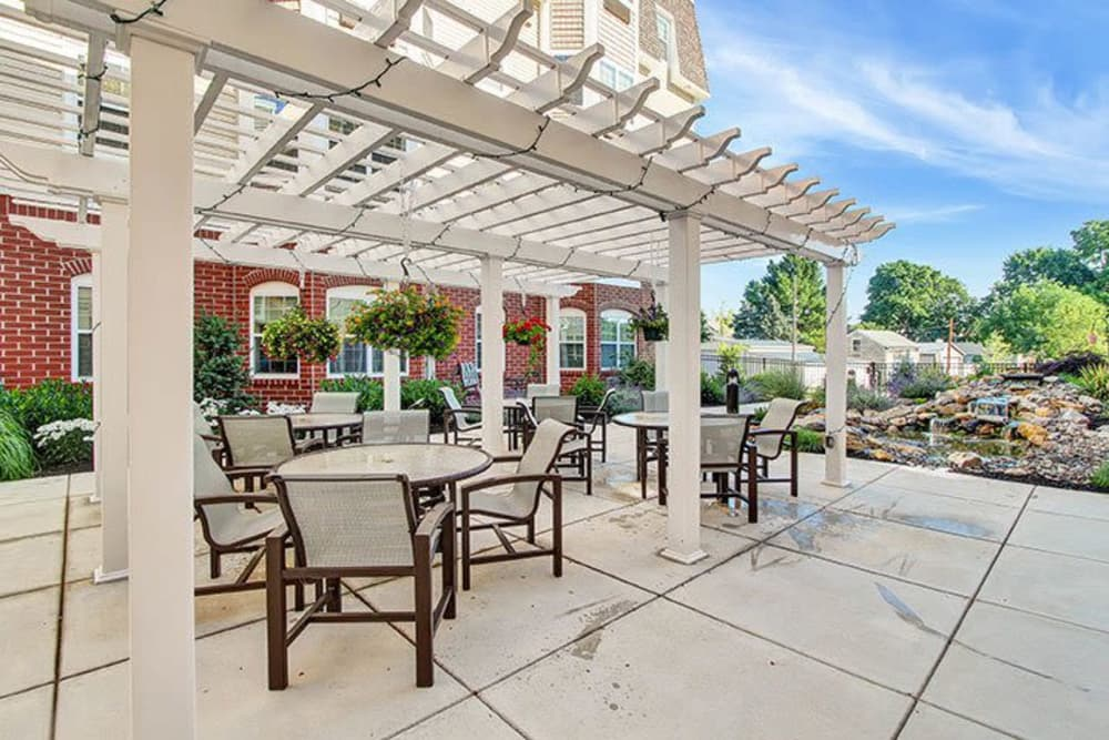 Outdoor patio with trellis at Keystone Villa at Ephrata in Ephrata, Pennsylvania