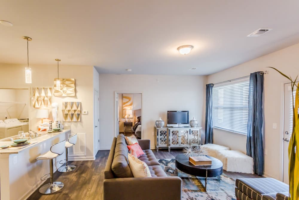 An apartment living room and kitchen with wood flooring at Landmark Apartments in Little Rock, Arkansas