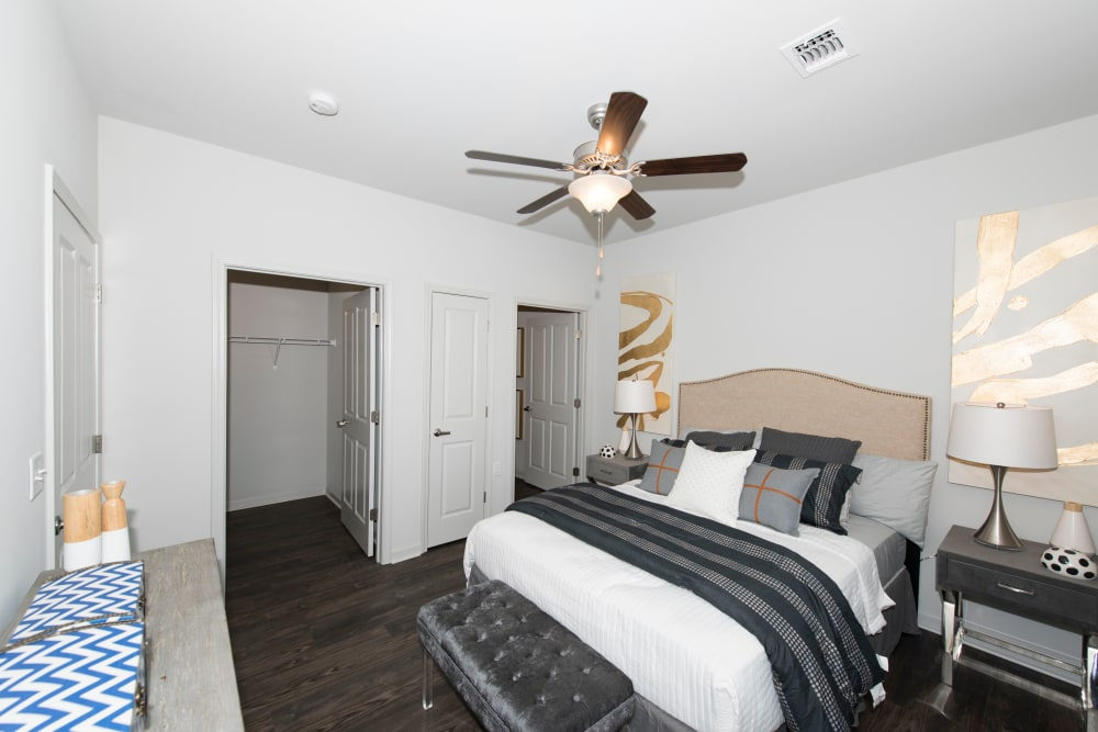 A master bedroom with a walk-in closet and bathroom at Landmark Apartments in Little Rock, Arkansas
