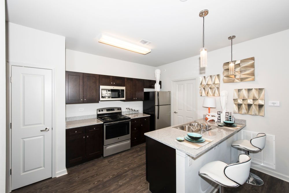 An apartment kitchen with upgraded counter tops at Landmark Apartments in Little Rock, Arkansas