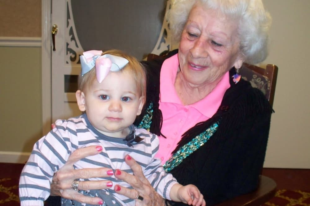 Resident holding a baby on her lap at Heritage Hill Senior Community in Weatherly, Pennsylvania