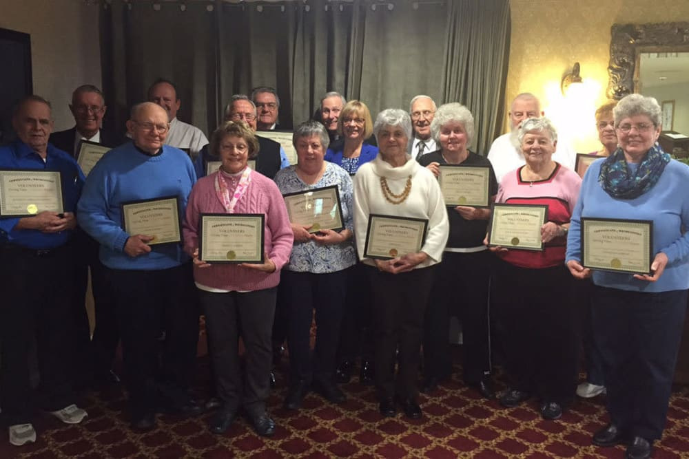 Staff presenting awards at Heritage Hill Senior Community in Weatherly, Pennsylvania