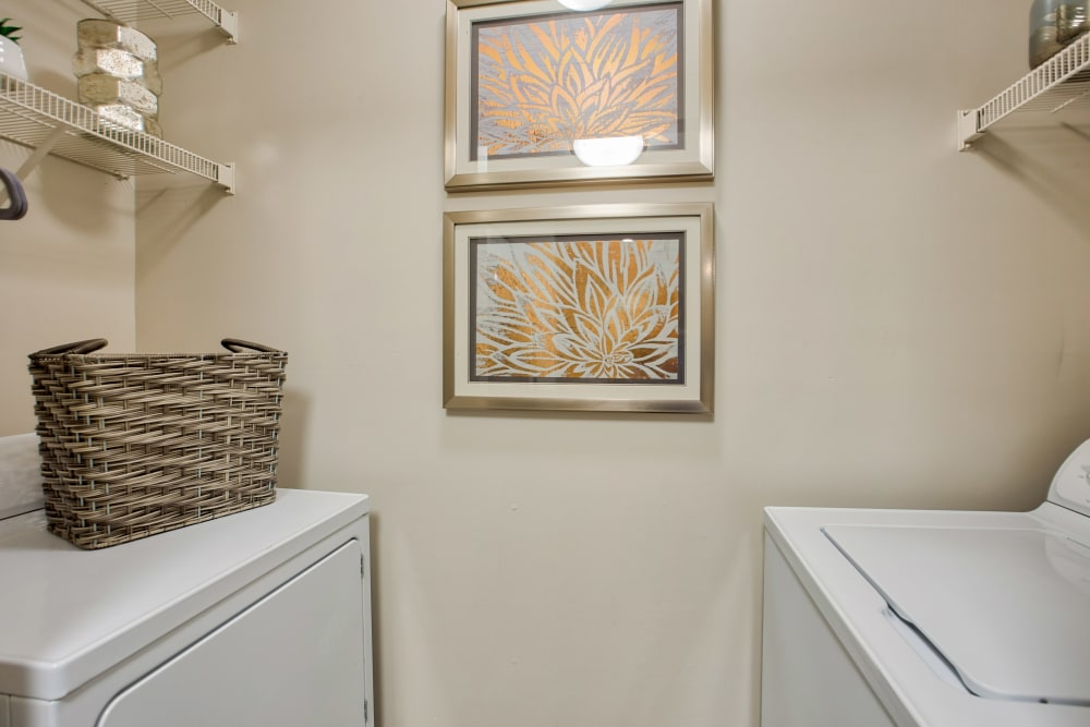 Full-size washer and dryer in laundry room of apartment