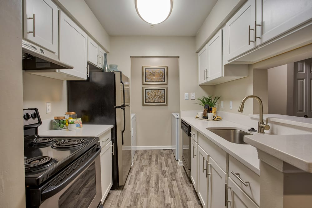 Upgraded galley kitchen with stainless-steel appliances