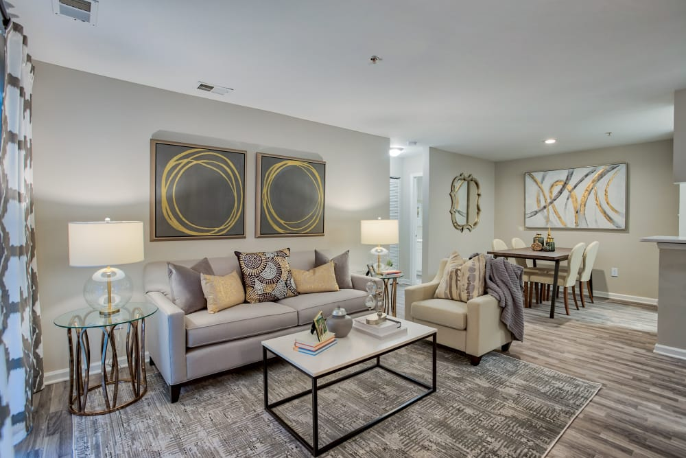 Upgraded living room with wood-style flooring at Hunter's Chase Apartments