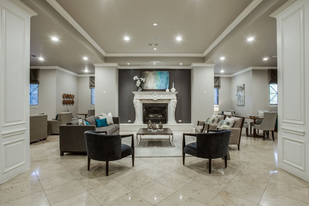 Lobby with a fireplace at Rienzi at Turtle Creek Apartments in Dallas, Texas