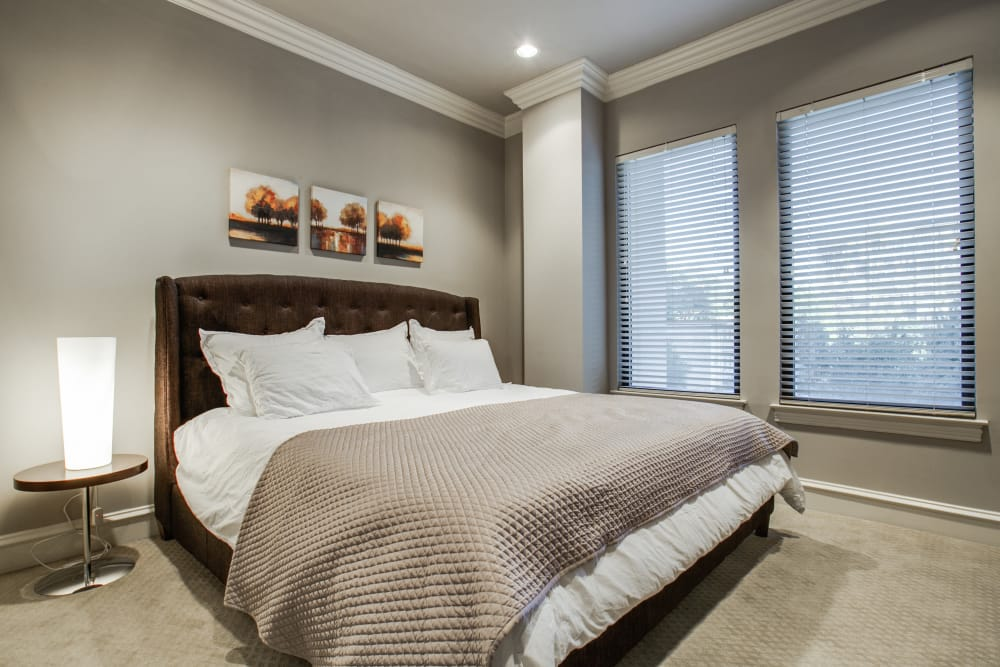 Master bedroom at Rienzi at Turtle Creek Apartments in Dallas, Texas