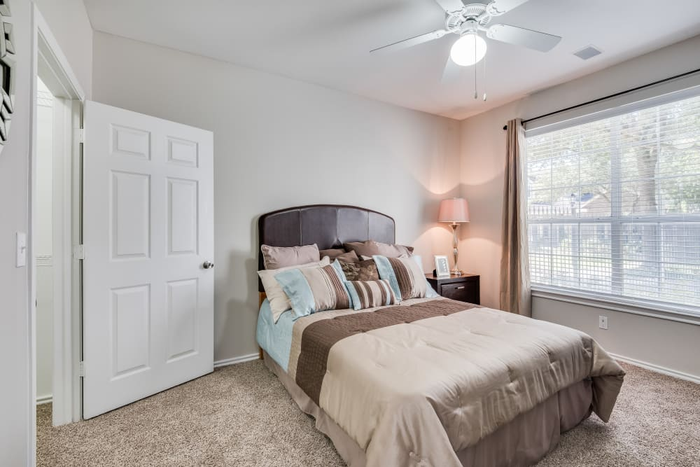 Master bedroom in a Ravinia Apartments home
