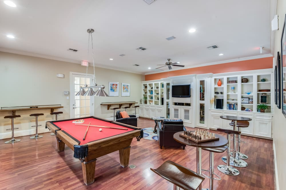 Pool table and game room at Ravinia Apartments