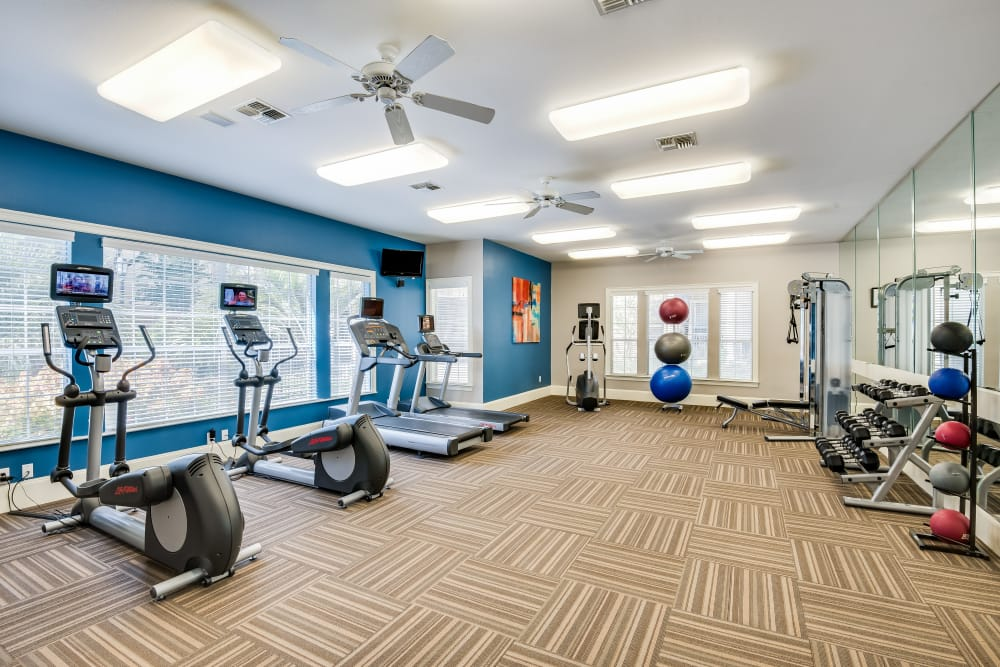 Fitness center with treadmills at Ravinia Apartments