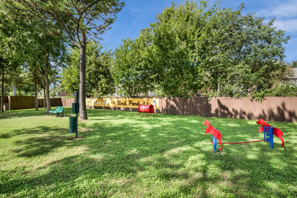 Spacious green dog park at Ravinia Apartments
