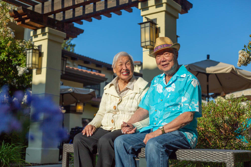 Two residents sitting outside a Merrill Gardens community.