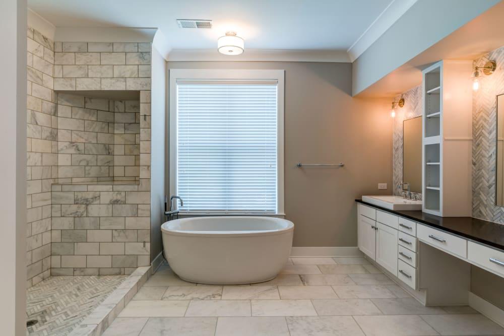 In-unit bathroom vanity & tub at Berkshire Dilworth in Charlotte, NC
