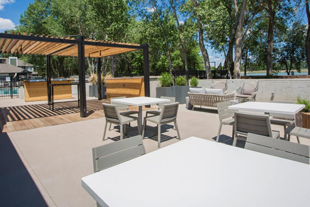 Outdoor picnic area at Community seating area at TAVA Waters in Denver, Colorado