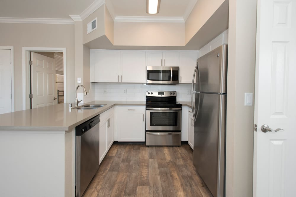 Kitchen with stainless-steel appliances and white cabinetry at The Vintage at South Meadows Condominium Rentals in Reno, Nevada