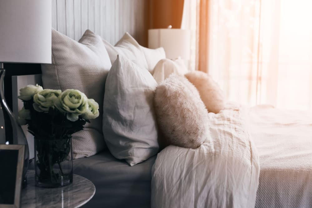 Pillows on a bed at Keystone Apartments in Madison, Wisconsin