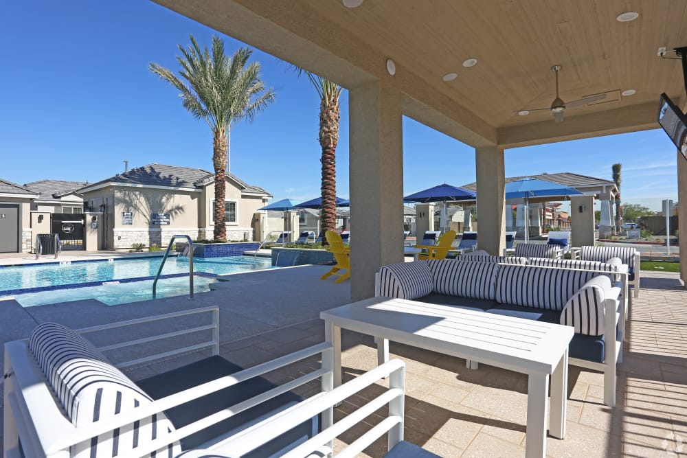 Beautiful swimming pool with nearby lounge seating at Christopher Todd Communities On Camelback in Litchfield Park, Arizona
