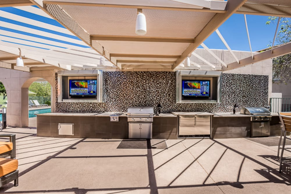 Pool deck with grill at The Golf Villas at Oro Valley in Tucson, Arizona