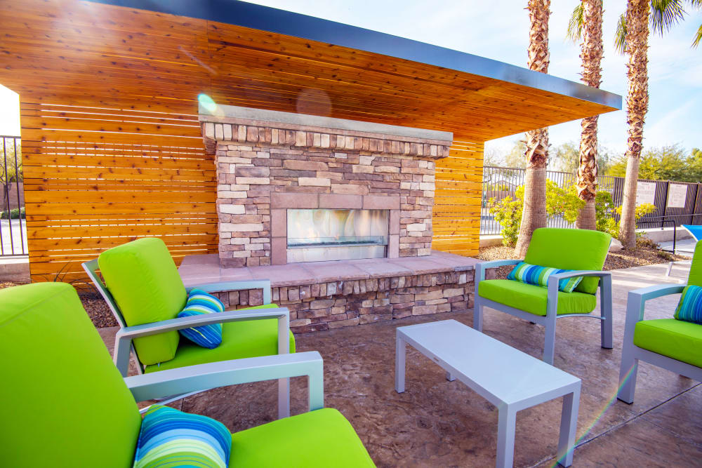 Outdoor Lounge w/ a Fireplace at Norterra Canyon Apartments in North Las Vegas, Nevada
