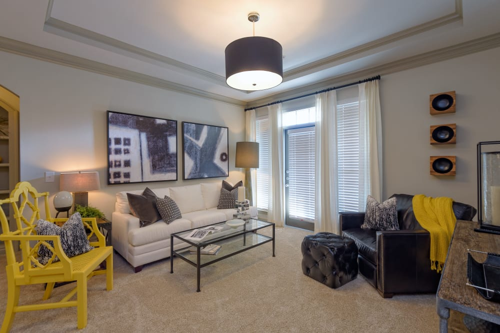 Model living room at Provenza at Old Peachtree in Suwanee, Georgia