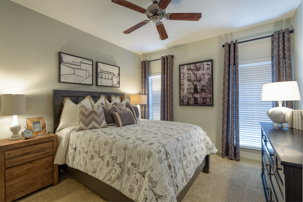 Bedroom with a ceiling fan at The Heights at Old Peachtree in Suwanee, Georgia