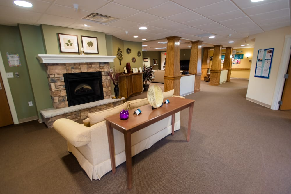 Lobby with a fireplace at Gardenview in Calumet, Michigan