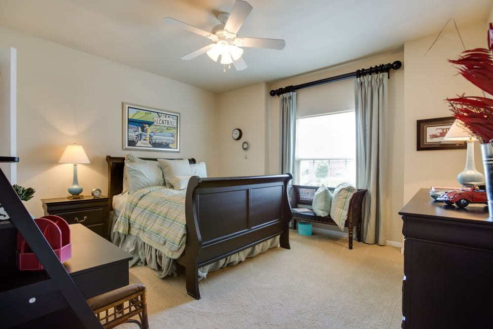 Large master bedroom with a ceiling fan at Reserve at Long Point in Hattiesburg, Mississippi