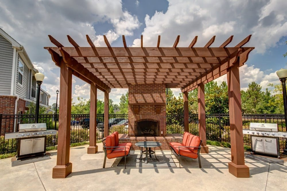 Gazebo with fire pit and comfortable seating at Reserve at Long Point in Hattiesburg, Mississippi
