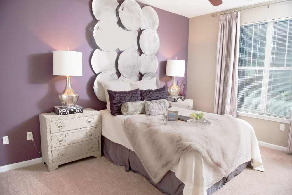 Carpeted bedroom at Manor Six Forks in Raleigh, North Carolina