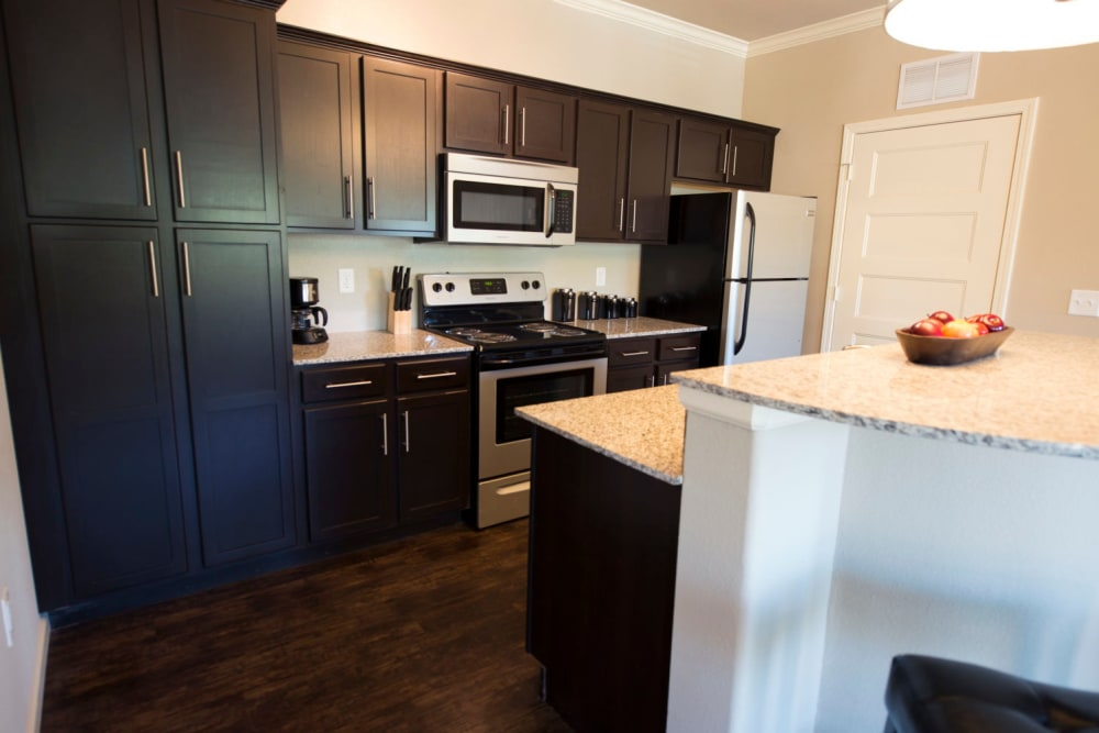 Large kitchen with stainless steel appliances at Tradan Heights in Stillwater, Oklahoma