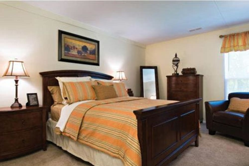 Master bedroom in model home at Willowbrook Apartments in Jeffersonville, Pennsylvania