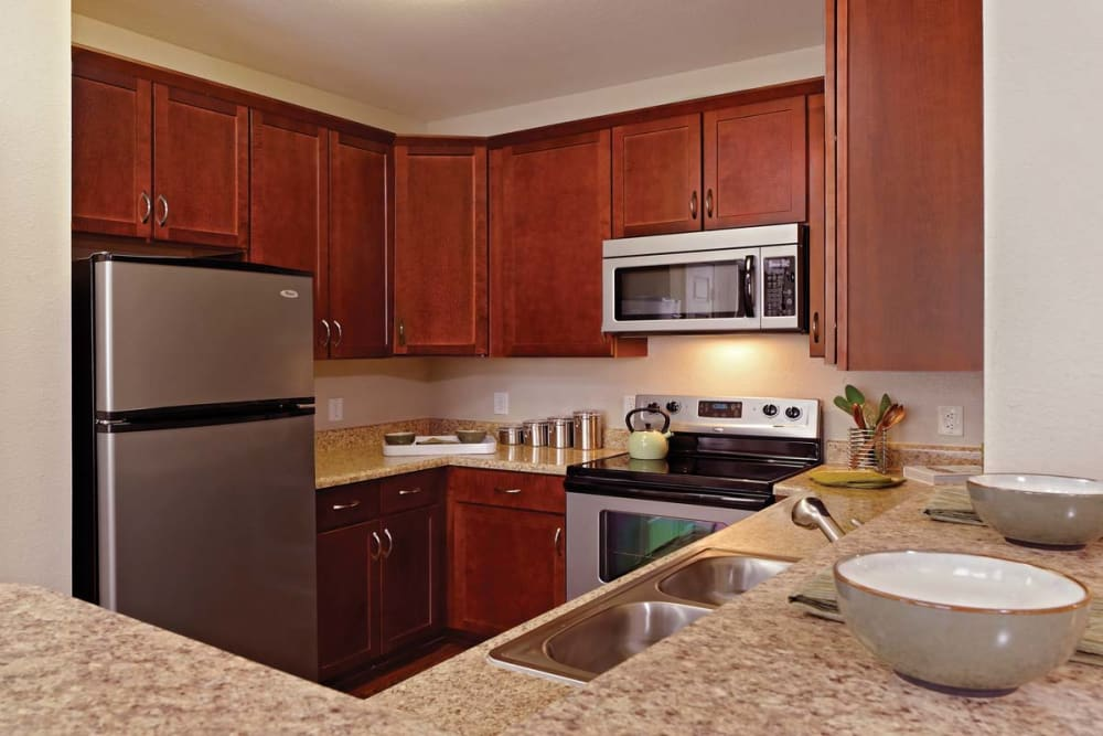 Fully equipped kitchen at The Village at Potomac Falls Apartment Homes in Sterling, Virginia