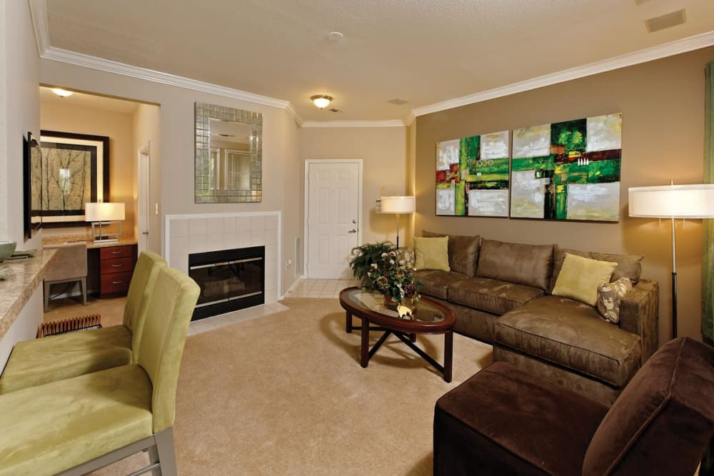 Living room with a fireplace at The Village at Potomac Falls Apartment Homes in Sterling, Virginia