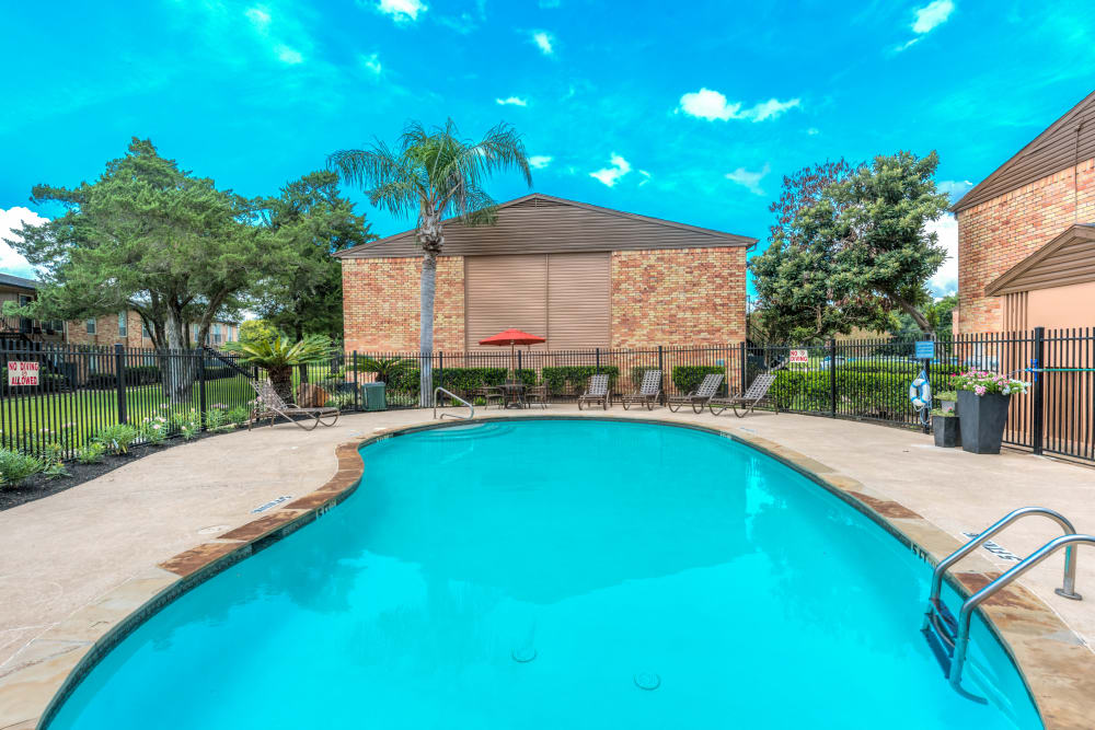 Refreshing pool at Newport Oaks Apartments in Alvin, Texas