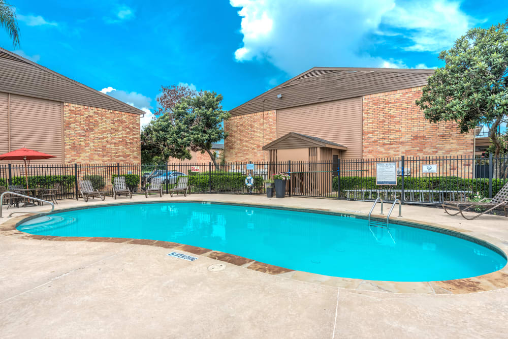 Gated pool at Newport Oaks Apartments in Alvin, Texas