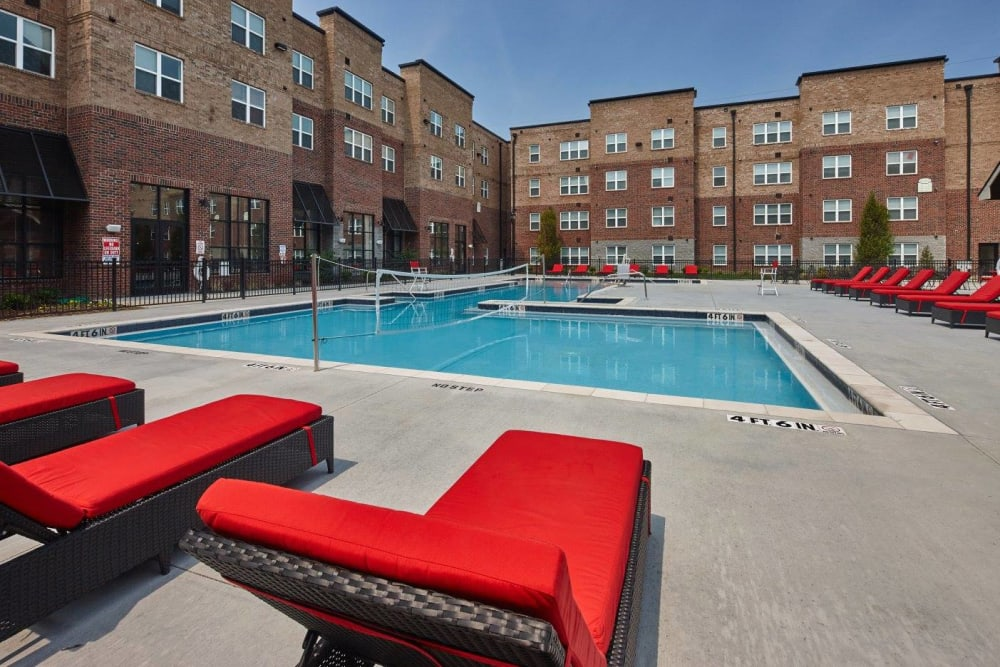 Lounge chairs around pool at Trifecta Apartments in Louisville, Kentucky.