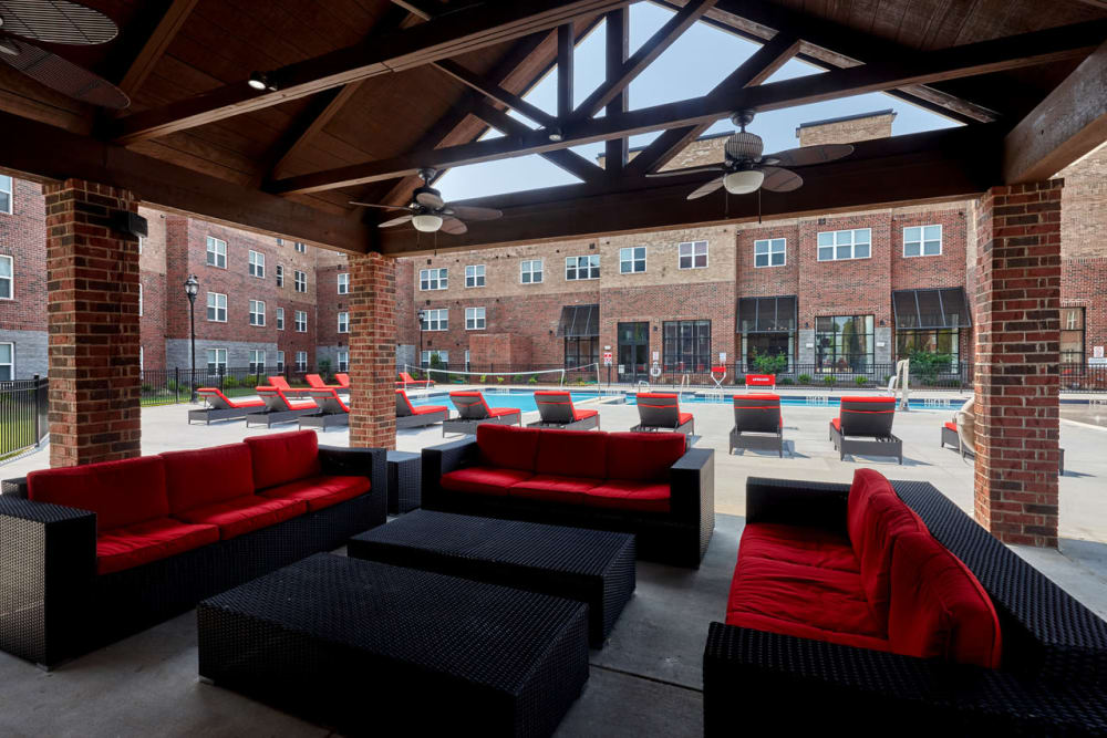 Covered seating around pool at Trifecta Apartments in Louisville, Kentucky.