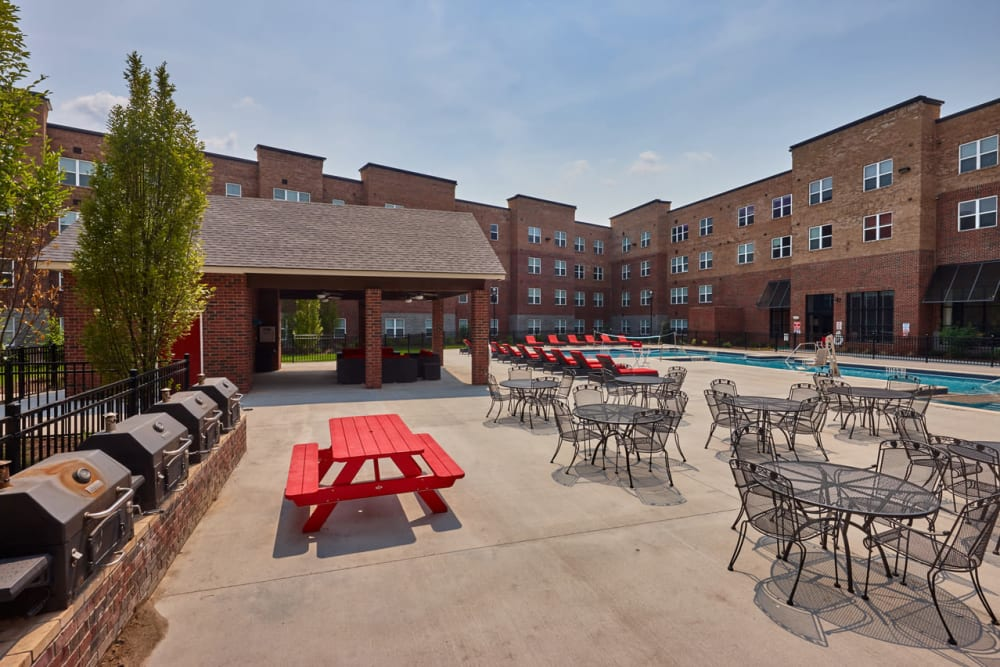 Outdoor grill with seating at Trifecta Apartments in Louisville, Kentucky.