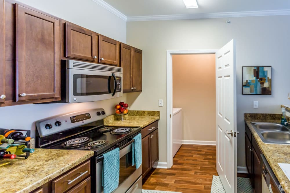 Kitchen leading to washer and dryer at Chenal Pointe at the Divide in Little Rock, Arkansas.