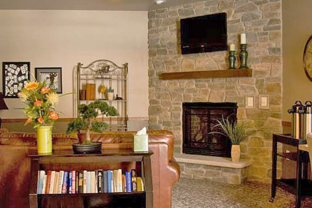Interior senior apartment with a fireplace at American Grand in Kaukauna, Wisconsin
