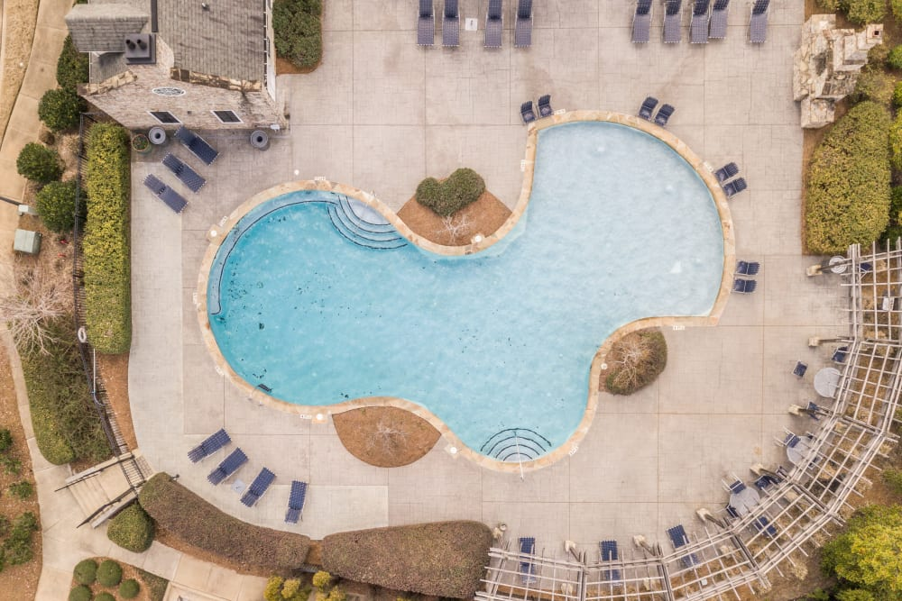 Top down view of community pool and grilling stations at Apartments at the Venue in Valley, AL