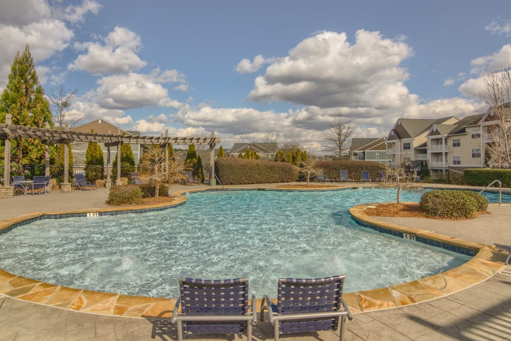 Spacious pool deck at Apartments at the Venue in Valley, AL